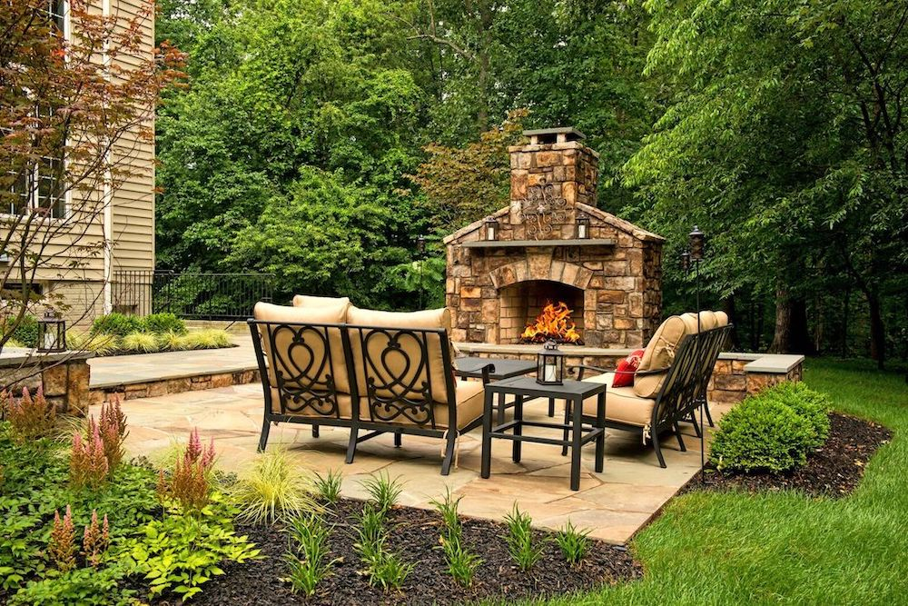 Natural stone fireplace on the edge of a patio