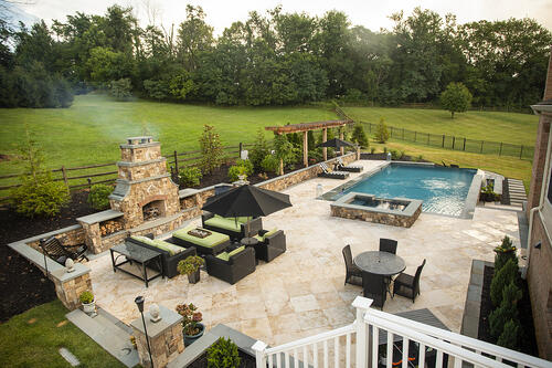 hardscape patio with fireplace and pool in Northern Virginia