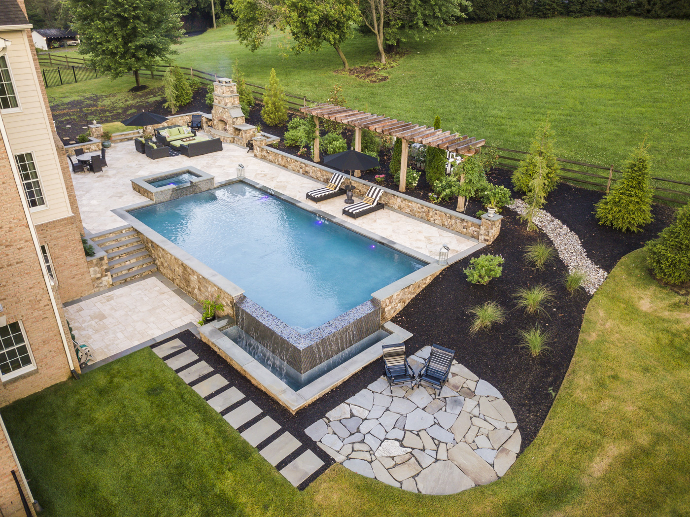 pool on a slope with multilevel patios