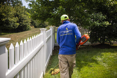 Rock Water Farm landscape maintenance technician trimming lawn in South Riding, VA