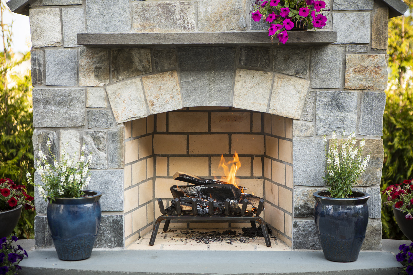 Natural stone wood burning outdoor fireplace