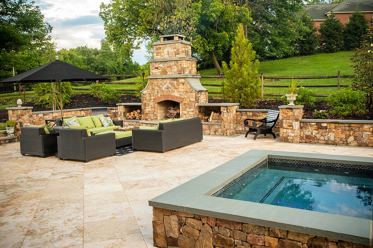 Patio with outdoor fireplace in Aldie, VA designed by Rock Water Farm