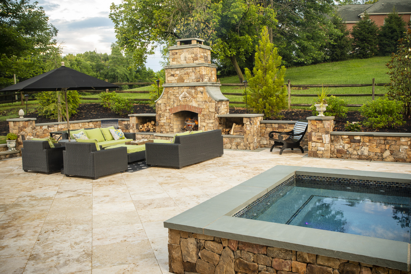 outdoor fireplace surrounded by shrubs