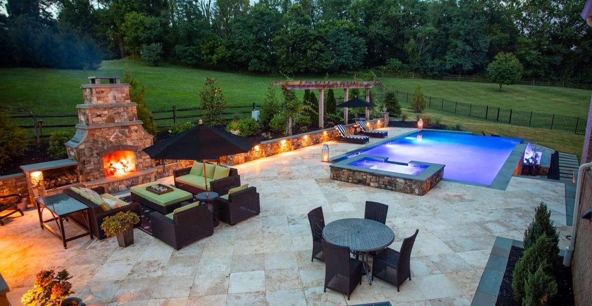 outdoor-fireplace-patio-pool-lighting-stone-wall-1