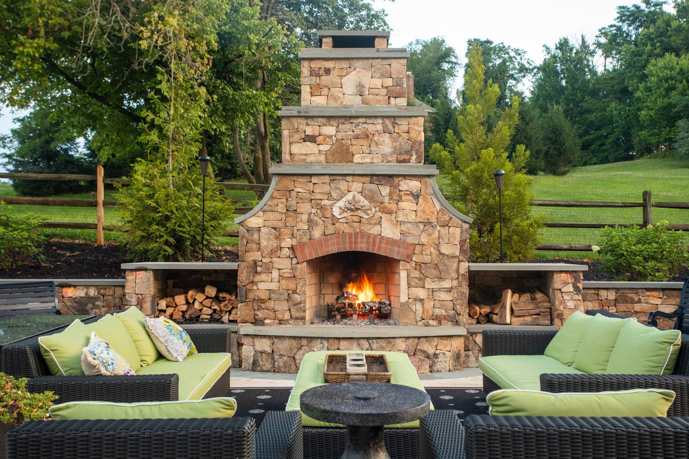 outdoor fireplace stone wall seating hardscape