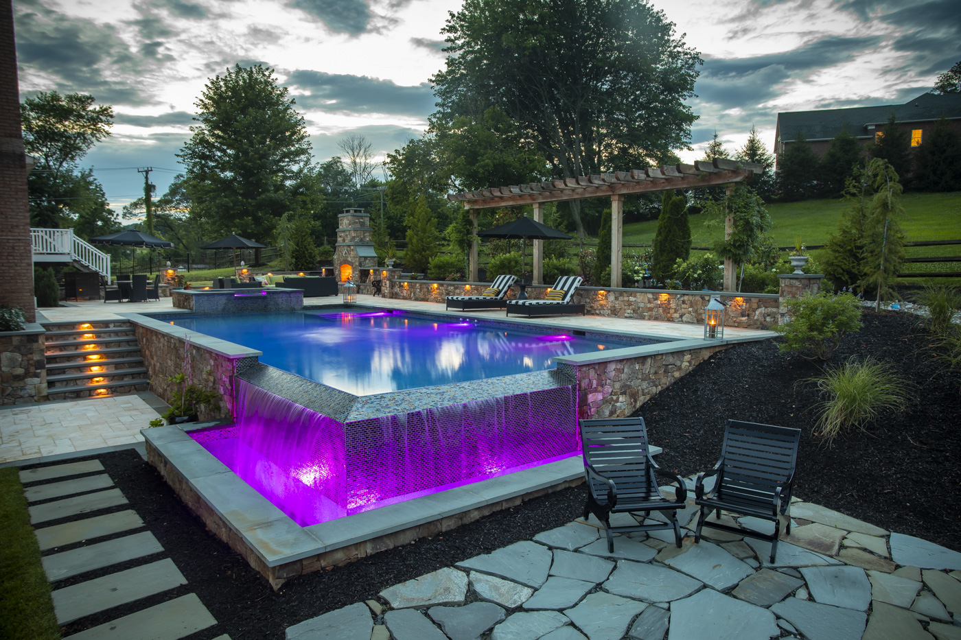 custom pool with infinity edge and lighting