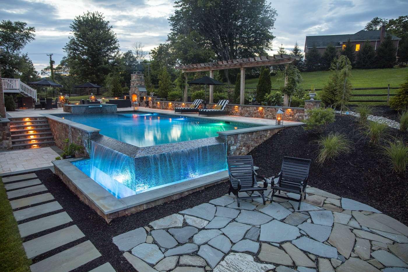 patio near infinity edge pool waterfall