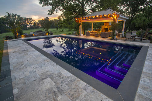 pool patio and pergola with lighting