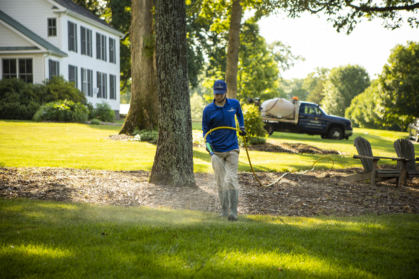 Rock Water Farm lawn care technician spraying lawn in Ashburn, VA