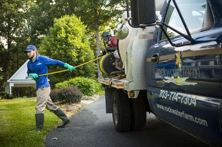 Rock Water Farm lawn care technician and truck