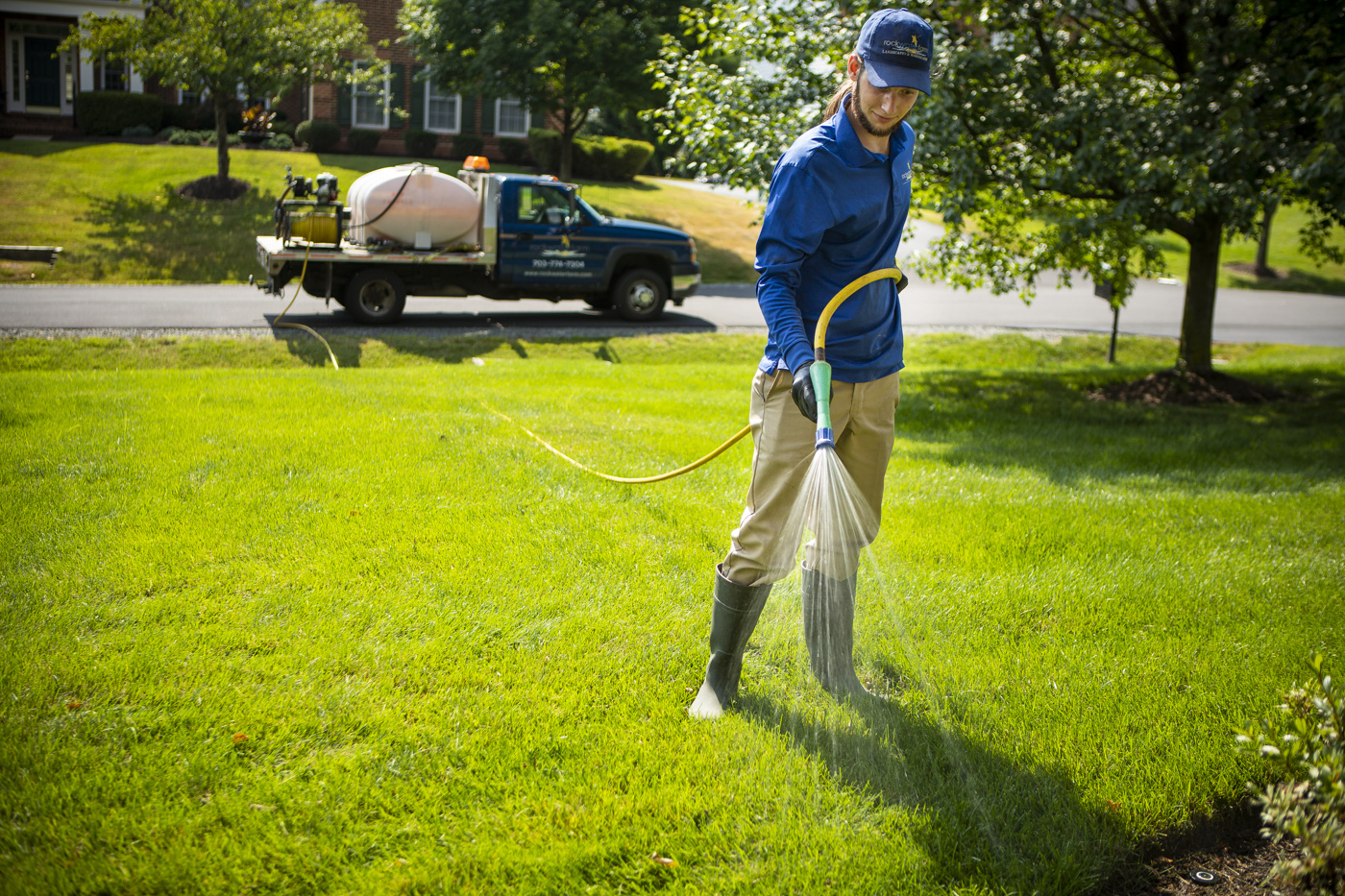 Rock Water Farm lawn technician spraying lawn