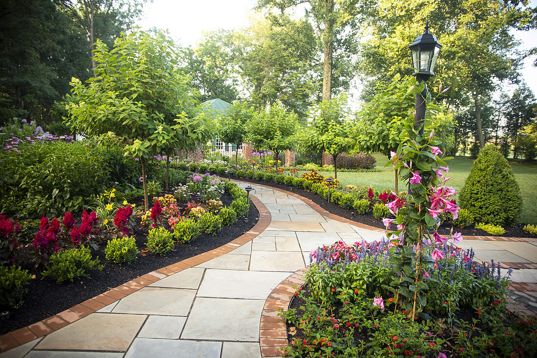 stone walkway and plantings designed by Rock Water Farm