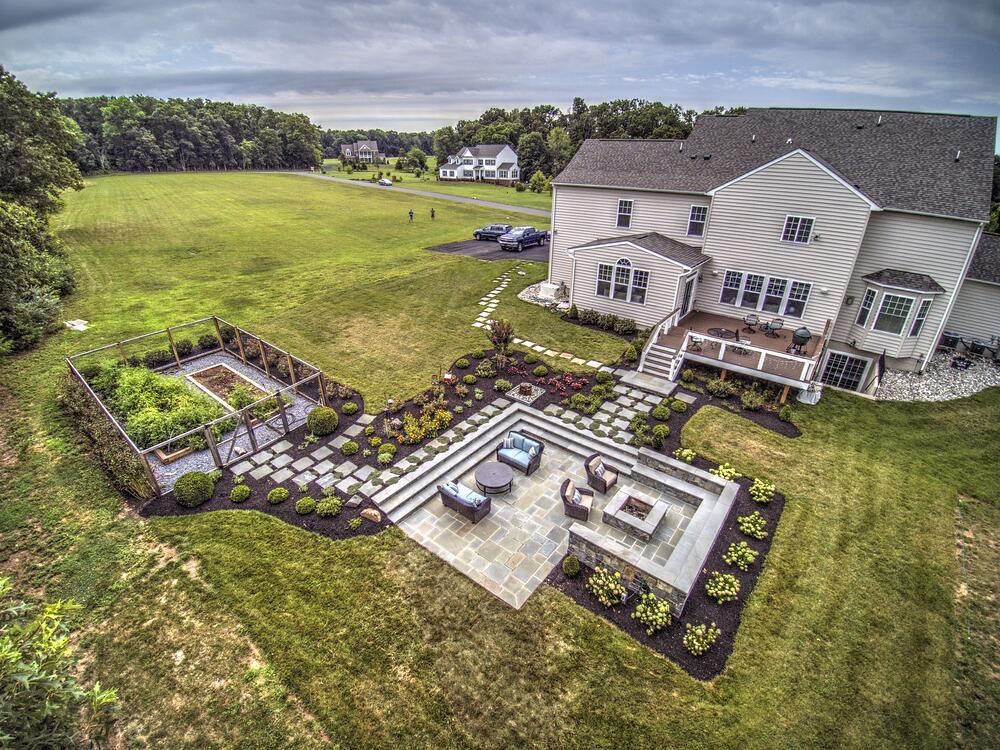 aerial view of patio and square fire pit