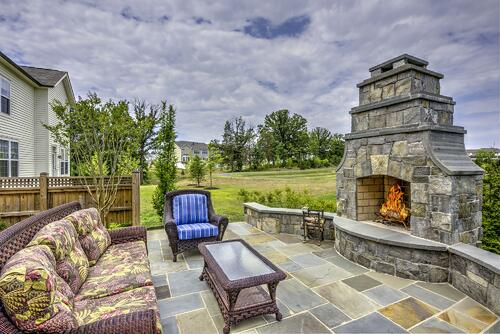 Outdoor fireplace in northern Virginia patio