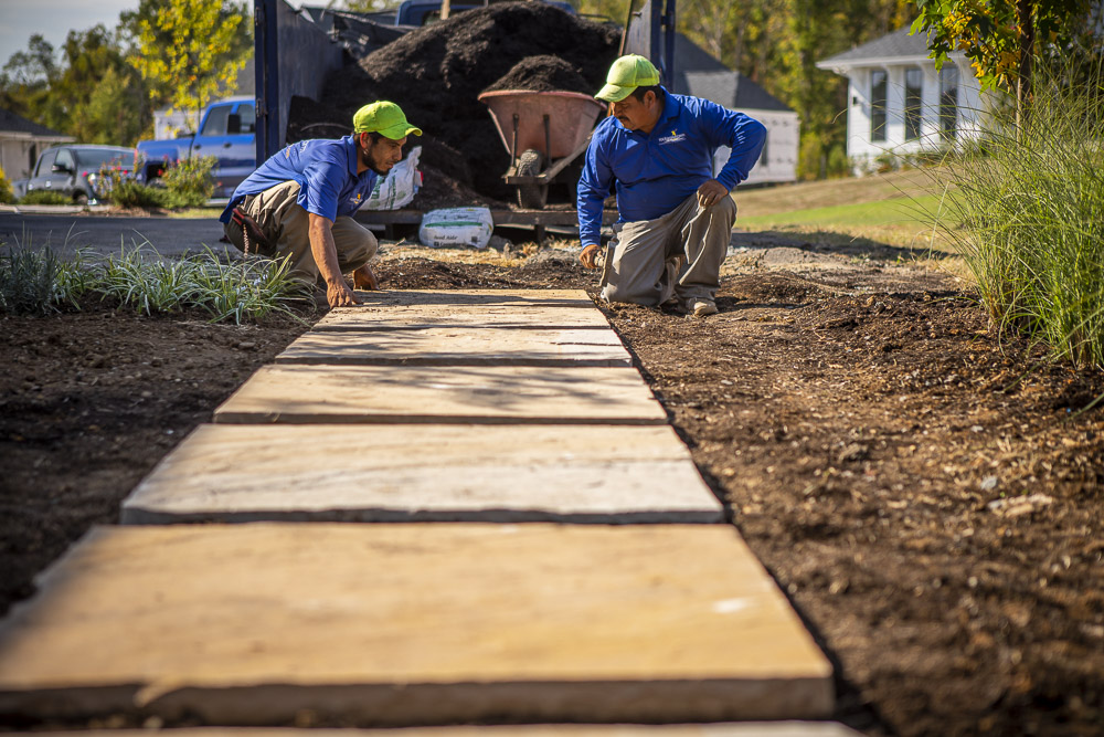 crew laying stepping stones