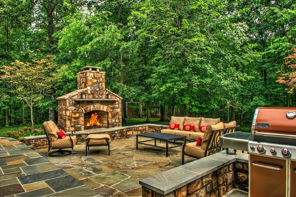 Outdoor fireplace, patio, and grill