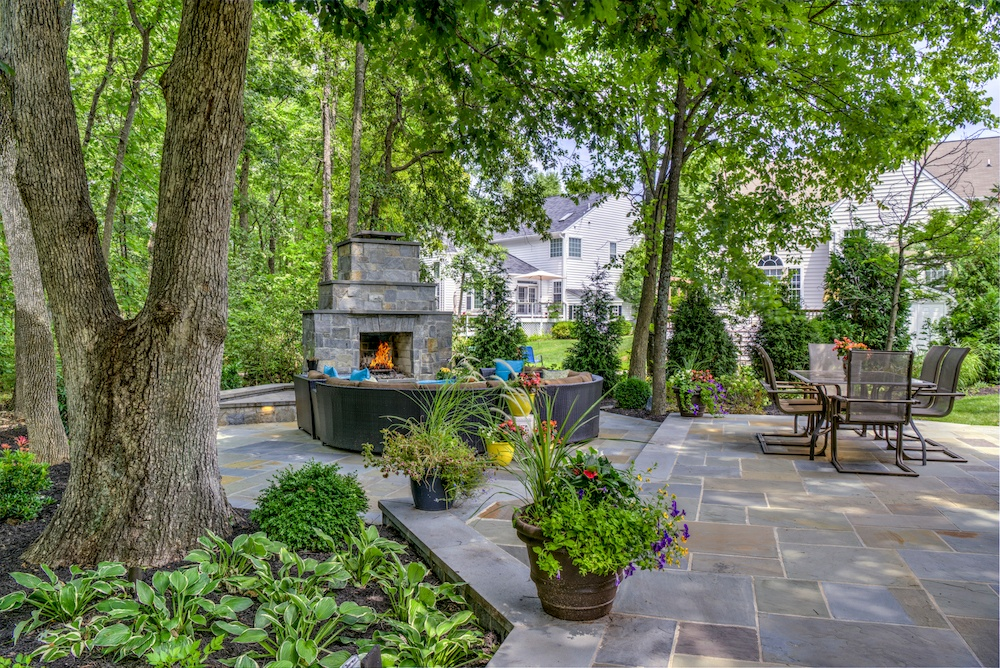 Patio with natural stone and outside fireplace