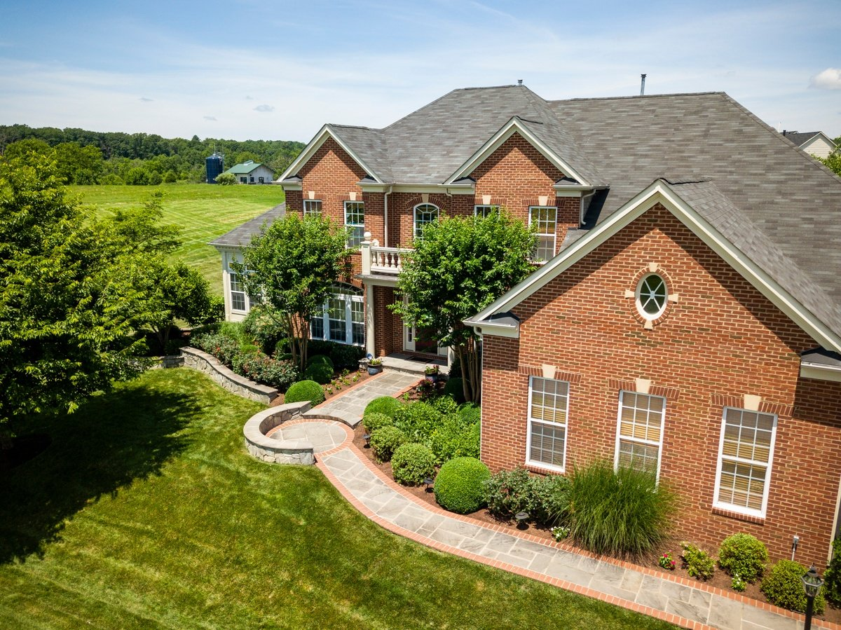 Beautiful house and landscape with walkway in Leesburg, VA