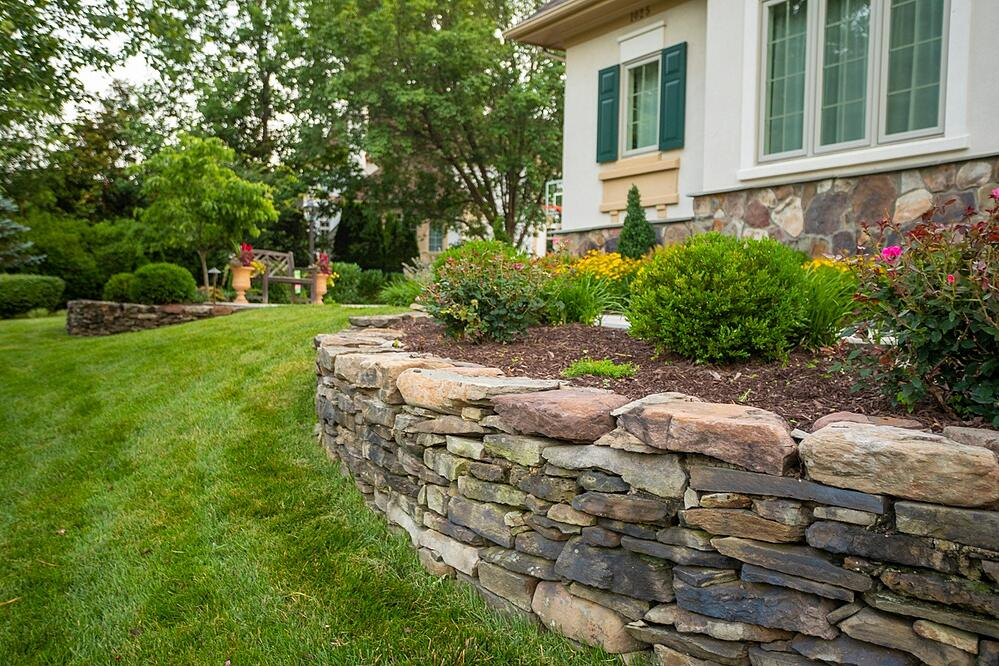 front walkway with stonewall and plantings in VA