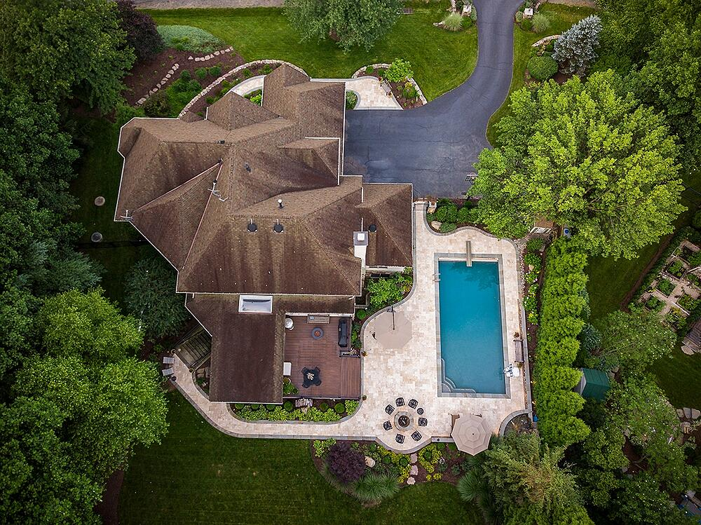 stone walkway, pool, and private backyard aerial view