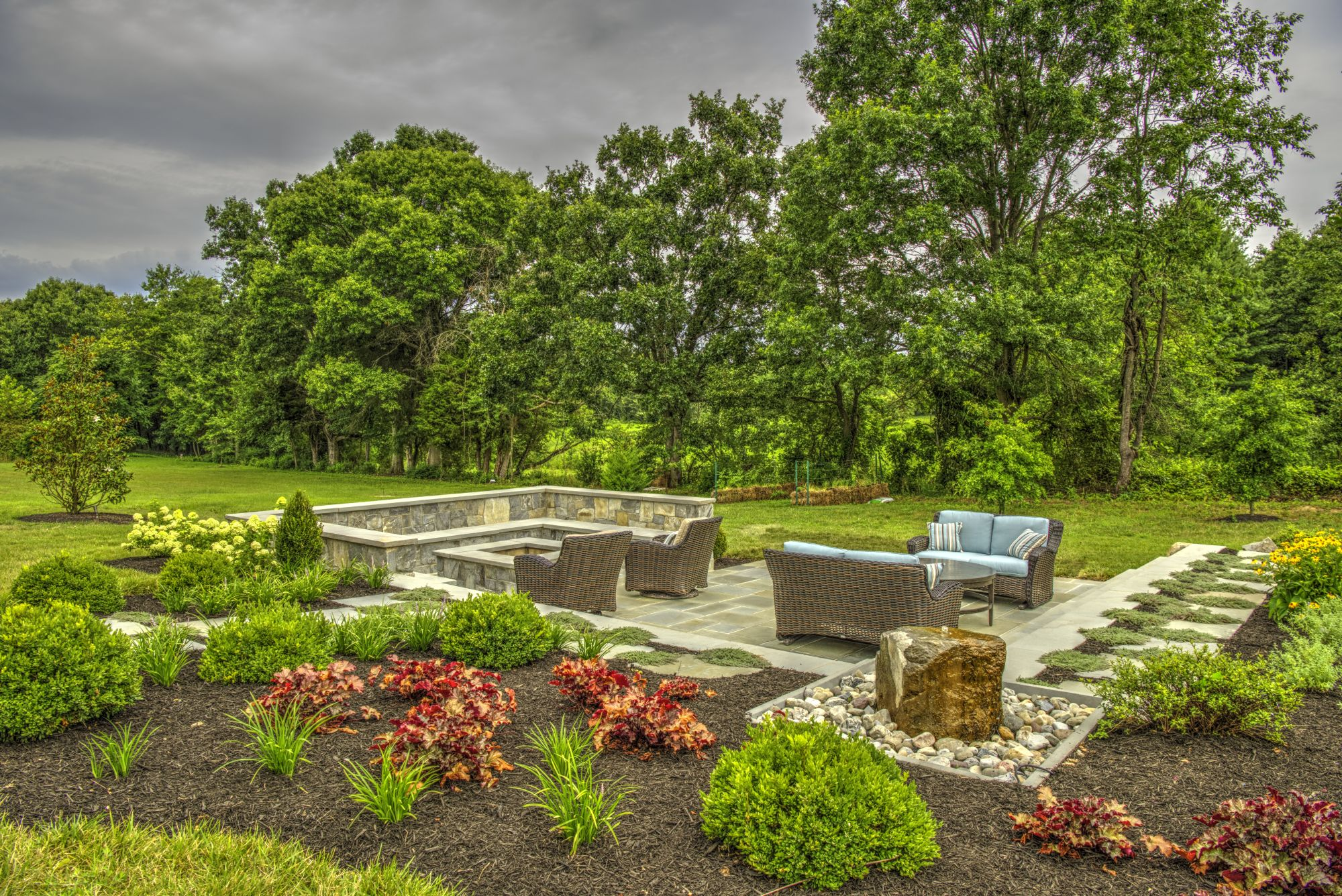 landscape with deer resistant trees, shrubs, and plants