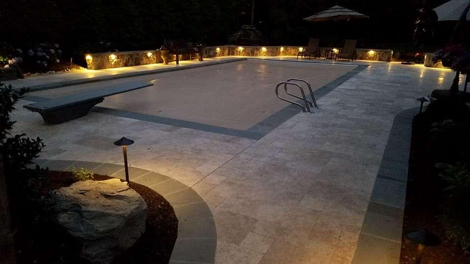 Travertine patio around a pool