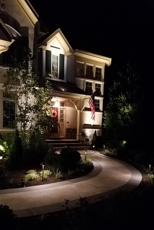 House with professional landscape lighting in Aldie VA