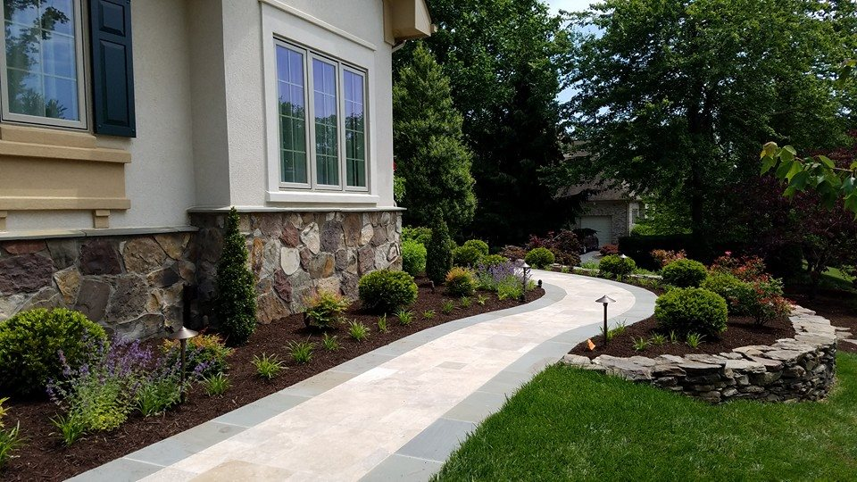 Stone walkway and landscape plantings