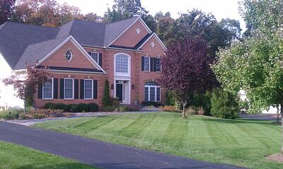 Nice green lawn in Aldie, VA cared for by Rock Water Farm