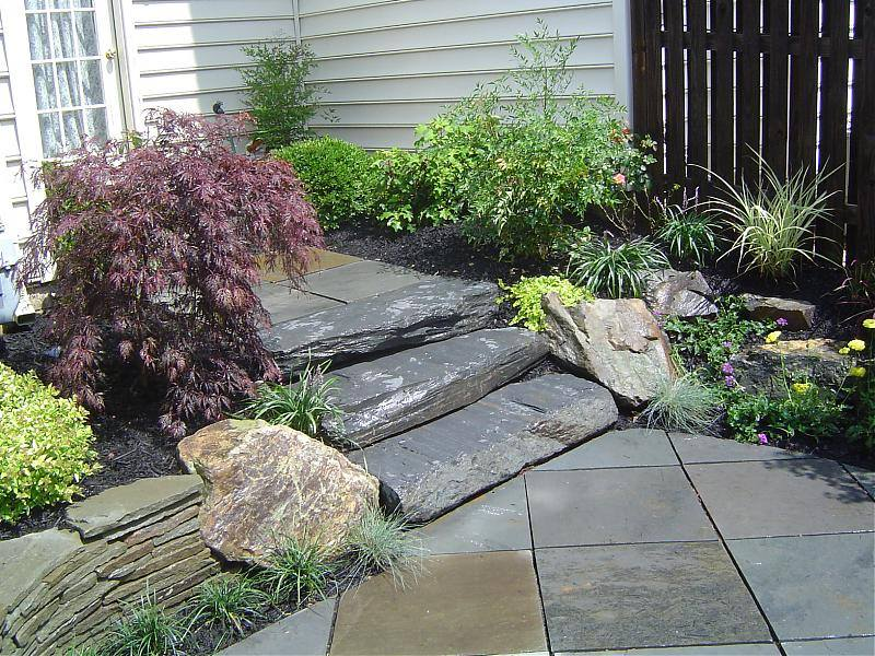 natural stone steps leading to a patio