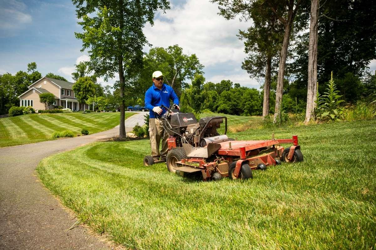 nice lawn worker mowing 1