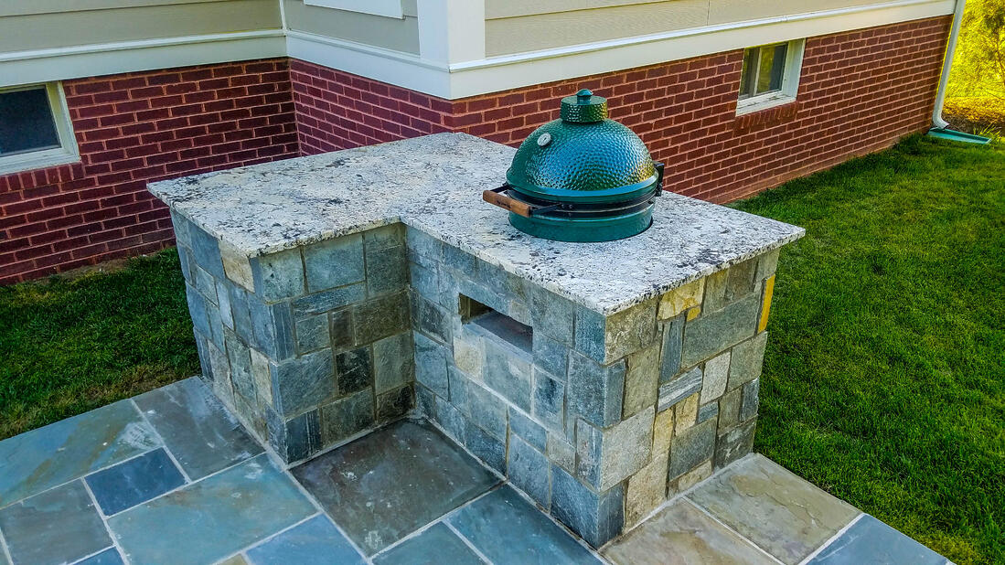 Outdoor kitchen built-in trash can