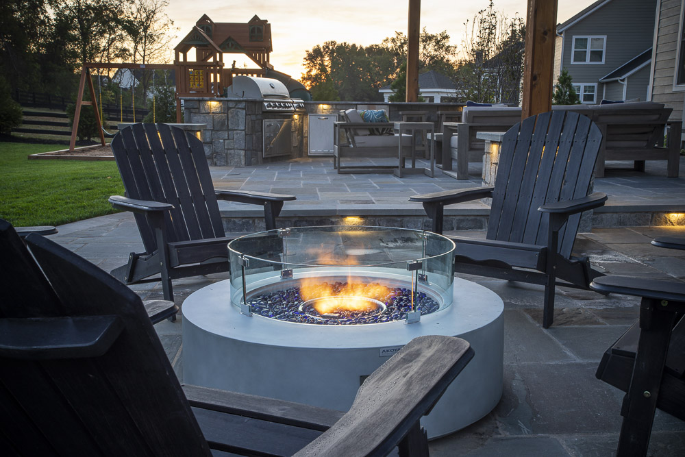 patio with gas fire pit and outdoor kitchen in Willowsford, VA