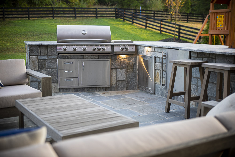 outdoor kitchen and patio designed by Rock Water Farm