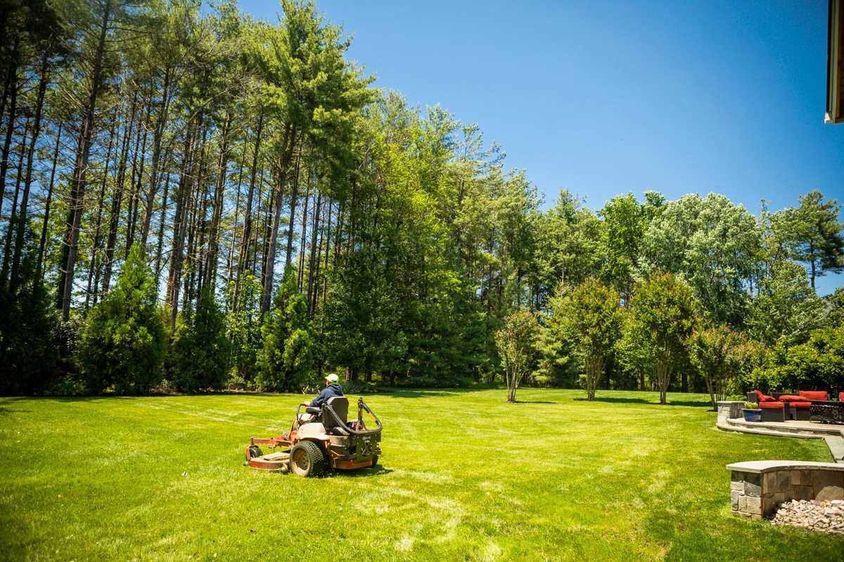 lawn mowing service being performed on nice lawn