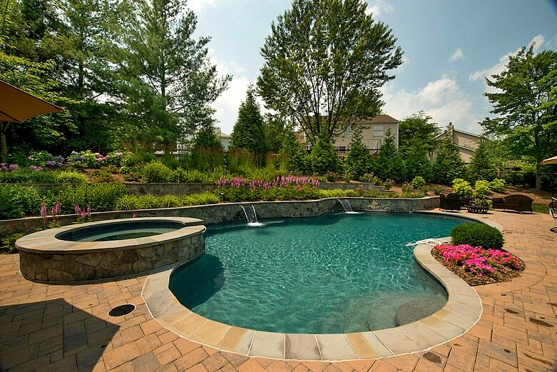 patio-pool-plantings-wall-waterfall-hot-tub.jpg