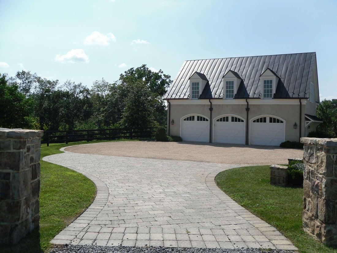 Paver driveway with stone pillars