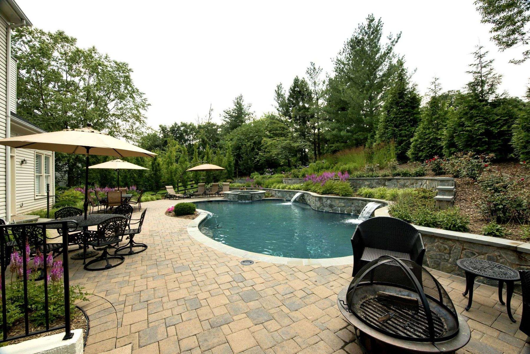 paver-patio-pool-hot-tub-waterfall