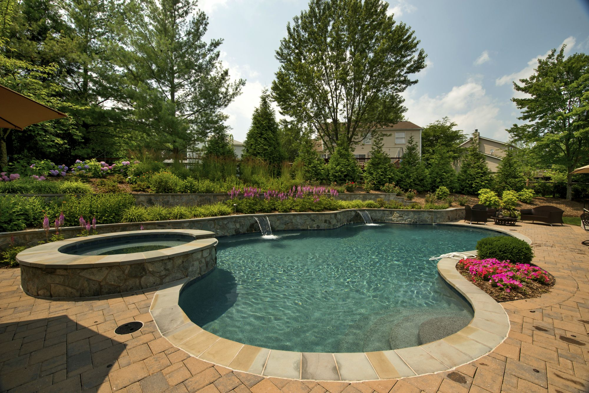 Pool with terrace walls and plantings