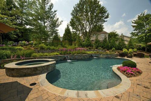 pool with retaining wall in sloped backyard