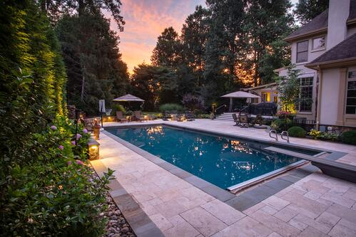 Pool and patio designed by Rock Water Farm