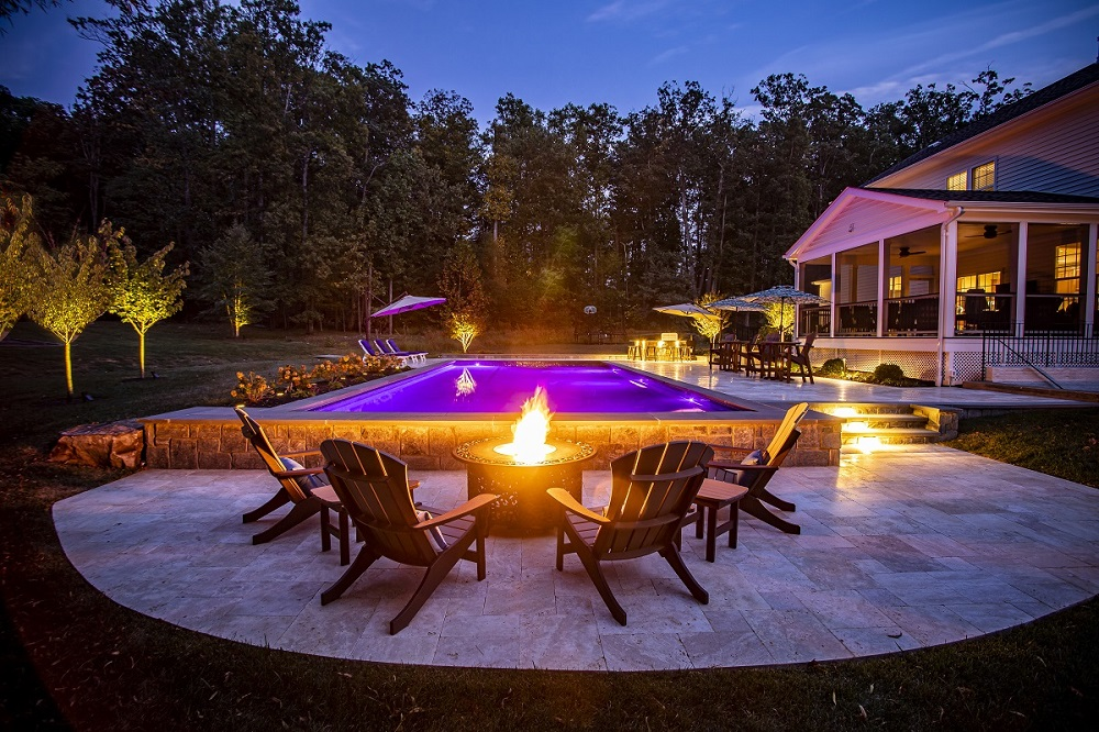 pool and patio fire pit at night in Round Hill, VA