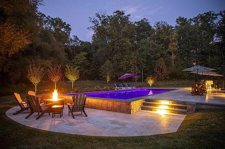 Patio and pool with beautiful landscape lighting