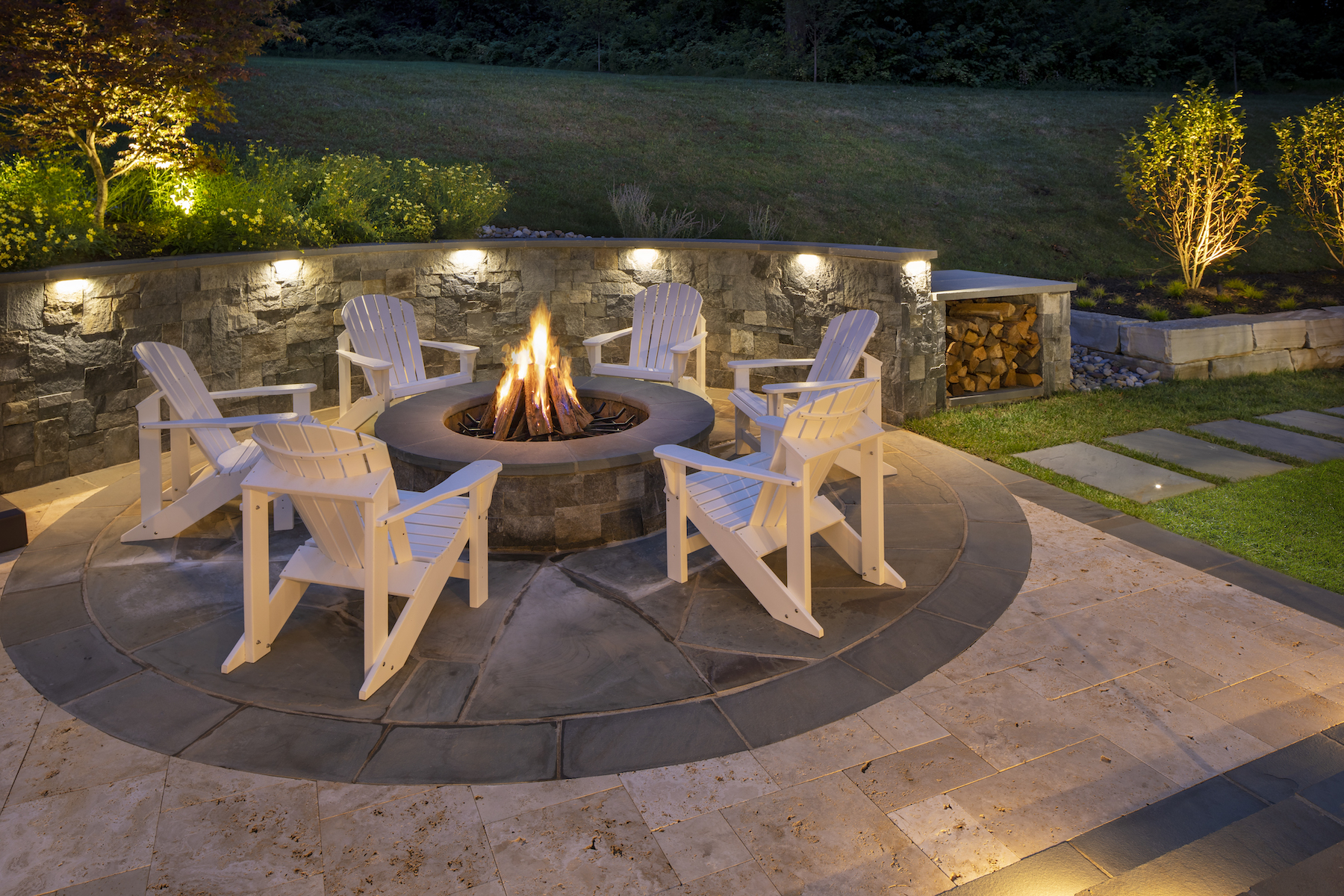 Patio with fire pit and landscape lighting