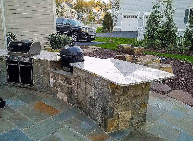 Outdoor kitchen with grill and smoker in Willowsford, VA