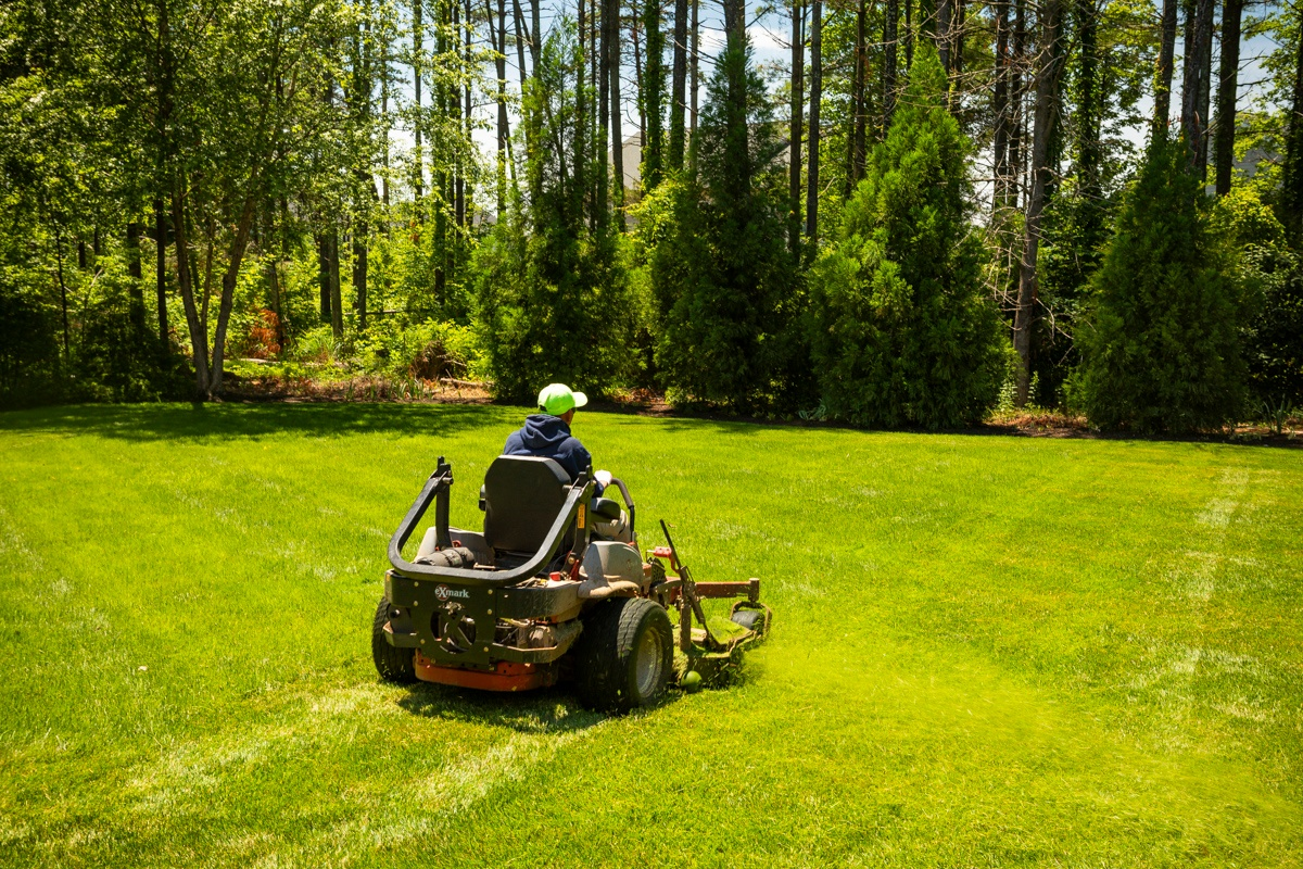 Lawn mowing crew working on a client's yard