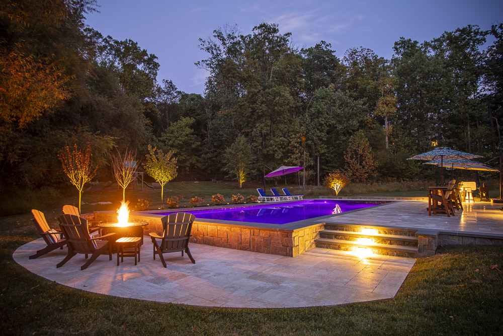pool patio and steps with landscape lighting
