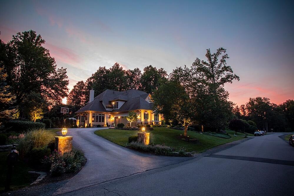 house with landscape lighting design in Great Falls, VA