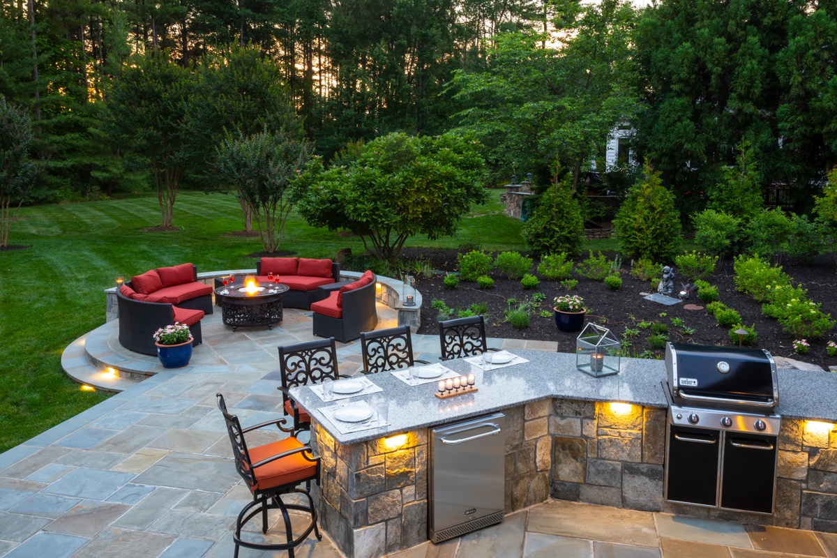 outdoor kitchen with lighting and fire pit