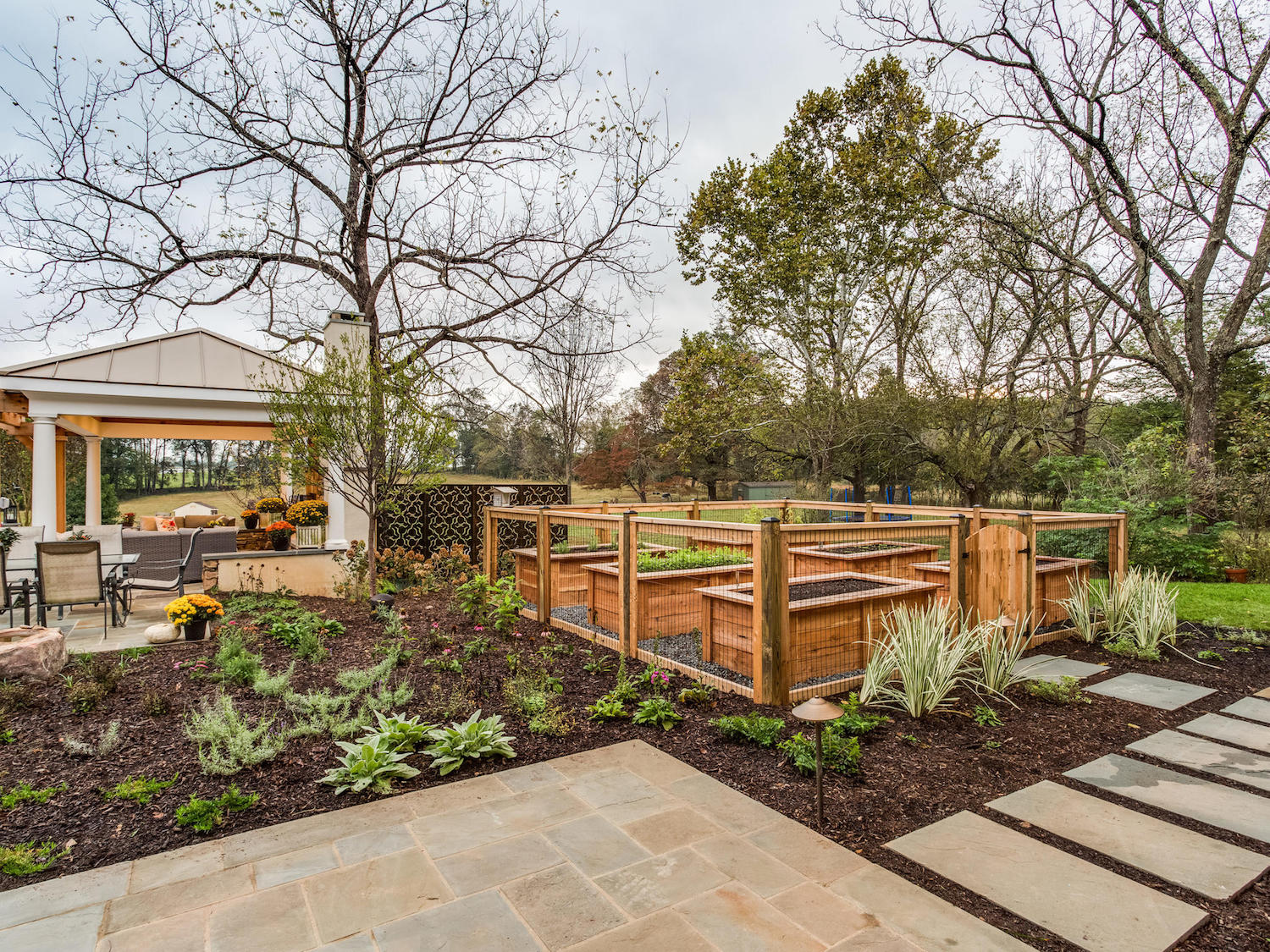 landscape design with multiple plants and a garden in Warrenton, VA